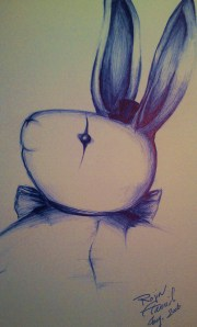 Stuffed bunny toy with top hat drawn in blue pen