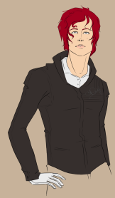 Crimson haired man wearing charcoal jacket with his gloved hand on his hip.
